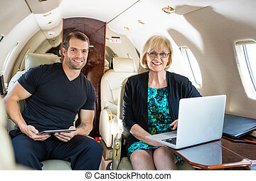 Confident Business People On Private Jet