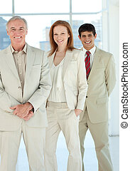 Confident business people standing together