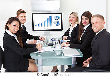 Confident Business Team At Desk