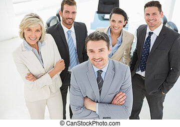 Confident business team in office