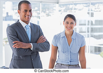 Confident business team smiling at camera