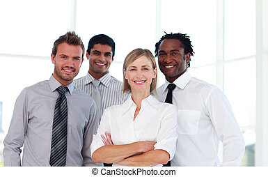 Confident business team smiling at the camera