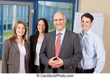 Confident Business Team Standing Together