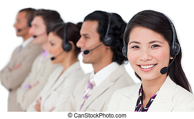 Confident business team with headset on standing in a row