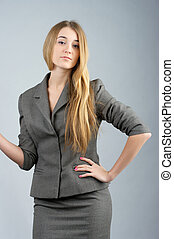 Confident business woman in gray suit