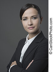 Confident business woman smiling with arms crossed