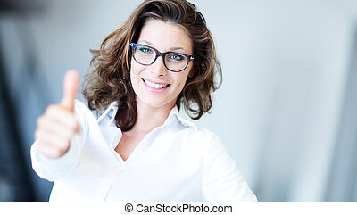 Confident business woman standing wearing elegant clothes with thumb up