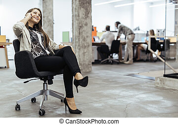 Confident business woman using phone