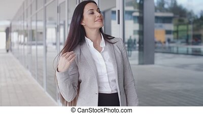 Confident business woman with folded arms