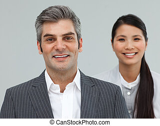 Confident Businessman and businesswoman in a line