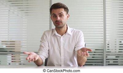 Confident businessman coach talking looking at camera...