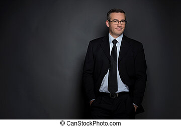 Confident businessman. Confident middle-age man in...
