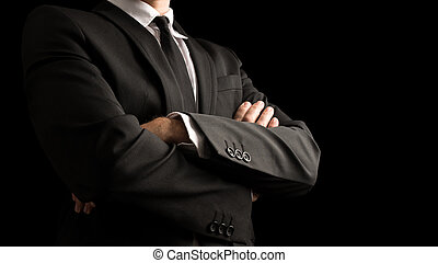 Confident Businessman Crossing Arms on Front