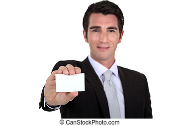 Confident businessman flaunting business card
