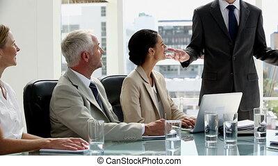 Confident businessman giving presen