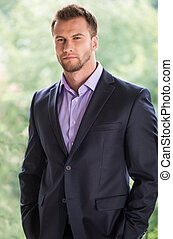 Confident businessman. Handsome young man in formalwear looking away