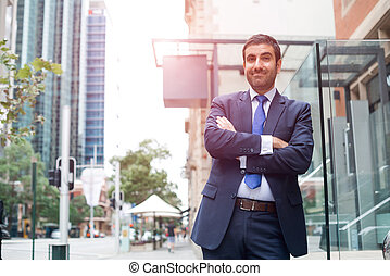 Smiling Arabian Businessman With Arms Crossed Over White