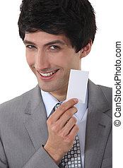 Confident businessman holding calling card