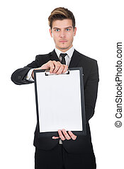 Confident Businessman Holding Clipboard With Blank Paper