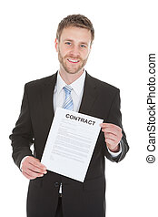 Confident Businessman Holding Contract Paper