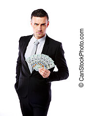 Confident businessman holding US dollars isolated on a white background