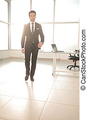 confident businessman in a modern office.