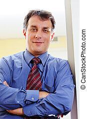 Confident businessman in blue shirt
