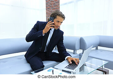 confident businessman in his office.