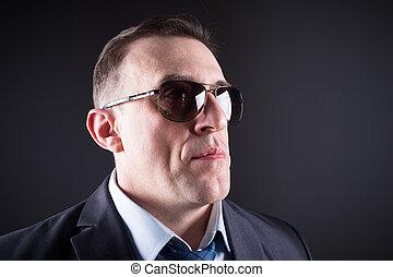 Confident businessman in sunglasses
