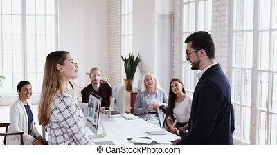 Confident businessman leader boss praising young proud ...