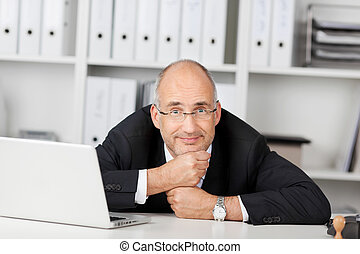 confident businessman leaning his head on