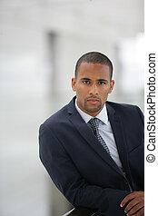 Confident businessman leaning
