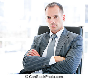 Confident businessman looking at the camera sitting