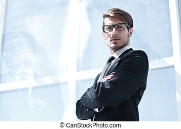 confident businessman looking at you