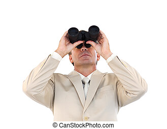 Confident businessman looking through binoculars