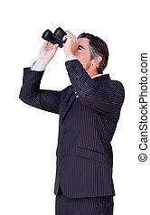 Confident businessman looking through binoculars isolated on...