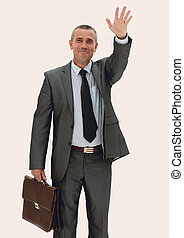 confident businessman making a welcoming hand gesture