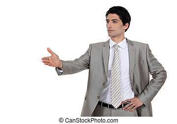 Confident businessman offering to shake hands