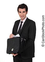 Confident businessman on white background
