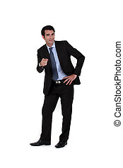 Confident businessman pointing at the camera