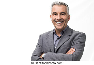 Confident businessman posing with arms crossed