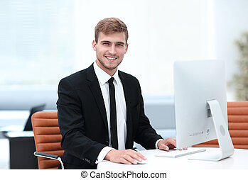 confident businessman sitting at his Desk.