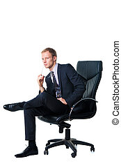 confident businessman sitting in black office chair
