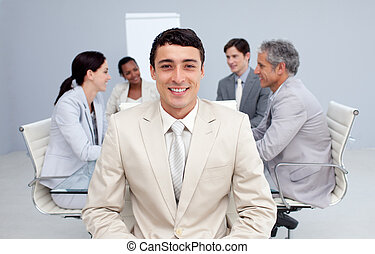 Confident businessman smiling in a meeting