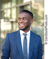 Confident businessman smiling in the city