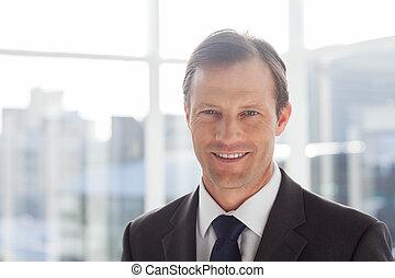 Confident businessman standing