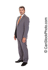 Confident Businessman Standing Over White Background