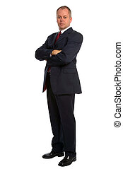 Confident businessman wearing a suit standing with his arms...
