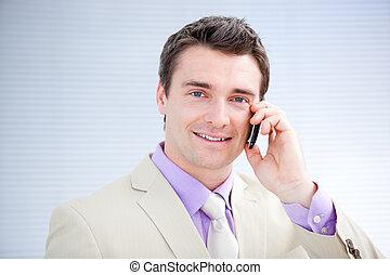 Confident businessman talking on phone