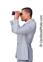 Confident businessman using binoculars